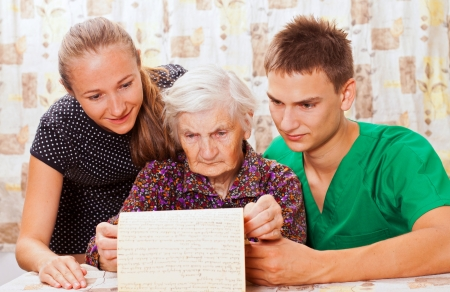 Elderly woman with the young doctors Stock Photo - 18068696
