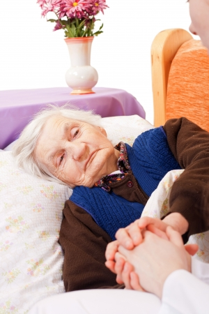 old carer: Elderly woman with the young doctor Stock Photo