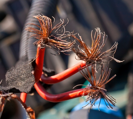 implied: Interrupted red cable with copper fibers inside