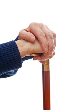 incapacitated: Elderly hands resting on the walking stick Stock Photo