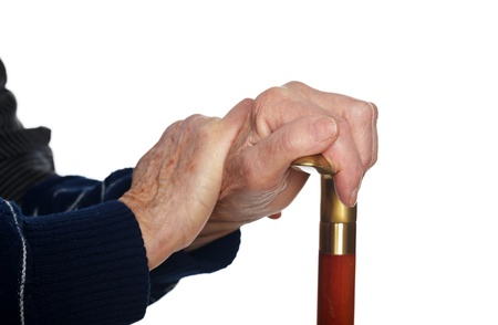 arthritic: Elderly hands resting on the walking stick Stock Photo