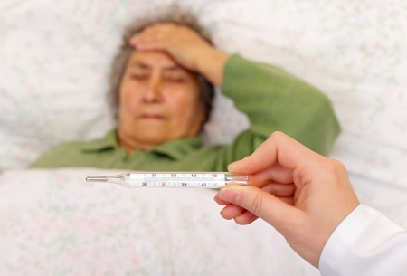 Having high fever and headache because getting flu Stock Photo - 19340478
