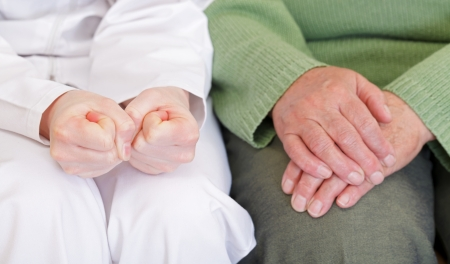 reassurance: Clasped anxious young and elderly relaxed hands