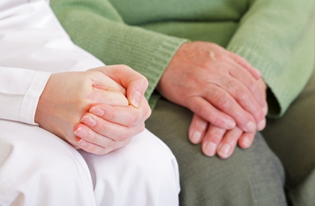 disharmony: Clasped anxious young and elderly relaxed hands