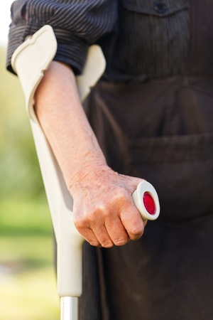 recuperating: Elderly woman hands resting on the crutch Stock Photo