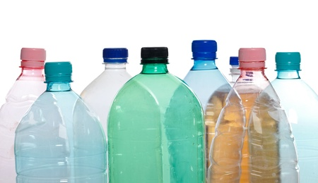 Transparent recyclable plastic bottles in different color photo