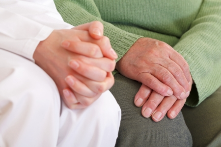 Clasped anxious young and elderly relaxed hands