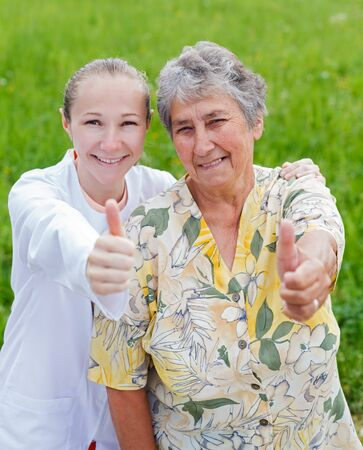 Happy elderly woman satisfied with her caretaker photo