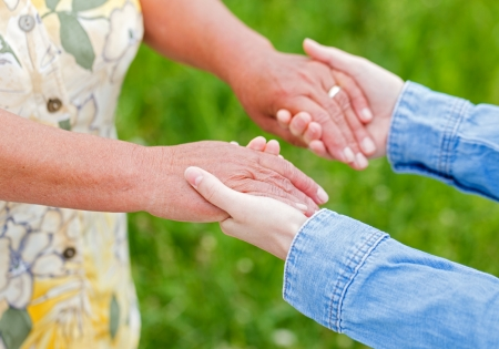 helping people: The young woman support the elderly woman Stock Photo