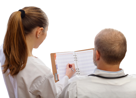 residents: Meeting between physicians to discuss the diagnosis or treatment of a case Stock Photo