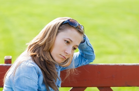 Young girl feeling unhappy because the loss Stock Photo