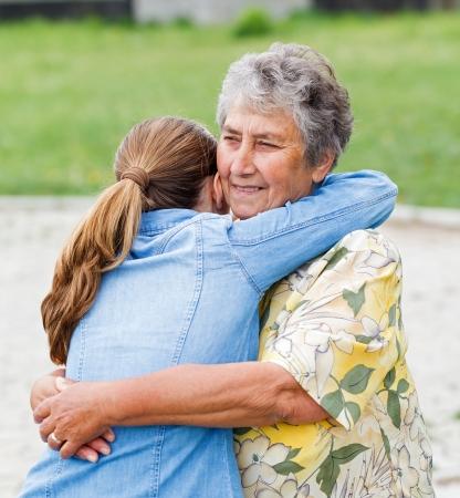 Young girl hug her mother and she enjoying photo