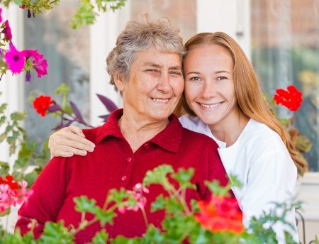 hospice: Happy elderly woman and her helpful assistant Stock Photo