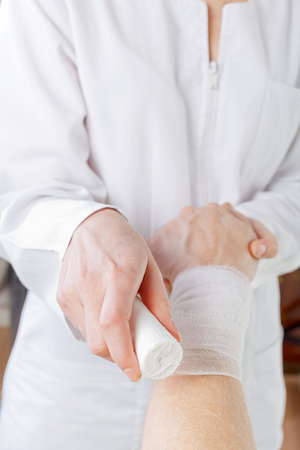 carpal tunnel: Wrist bandaging the therapy in the carpal tunnel syndrome Stock Photo