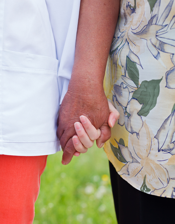Young doctor holds the elderly woman hands Stock Photo - 23309570