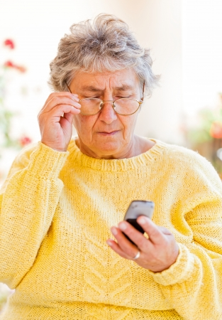 Elderly woman sitting on the veranda and waiting for a call Stock Photo - 23309593