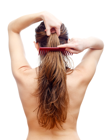 Comb your hair delicately after washing hair  photo