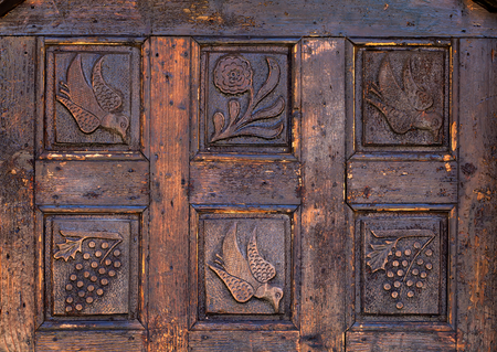 Carved wooden door with floral and birds motifs photo