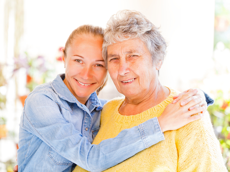 Elderly woman and her daughter enjoying themselves photo