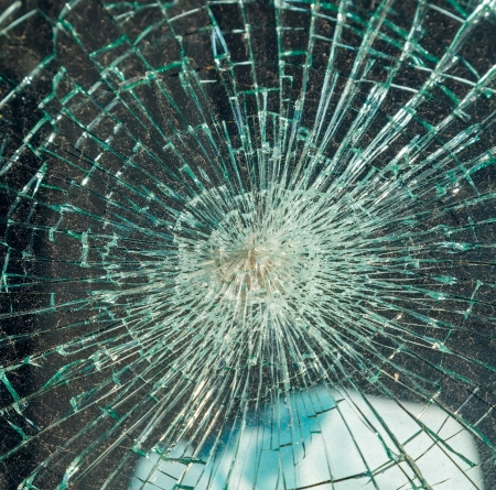 Close up photo of a broken windshield