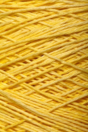 texture twisted: The yellow yarn skein used for knitting clothes