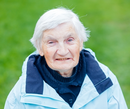 old carer: Portrait of the smiling elderly woman on outdoors Stock Photo