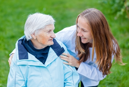 Portrait of elderly woman and her caregiver Stock Photo
