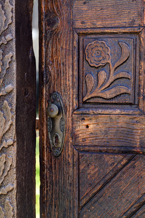 door handles: Open wooden door with carved floral  patterns
