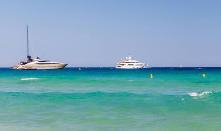 saint tropez: Beach, waves, yachts in bay of Saint Tropez