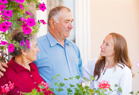 Happy elderly couple talking with the therapist photo