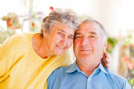 The portrait of a happy elderly couple  photo