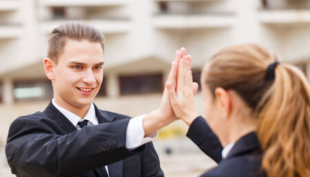 cooperating: Young business people after a successful deal