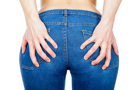 Close up of woman holding with her hands buttocks Stock Photo