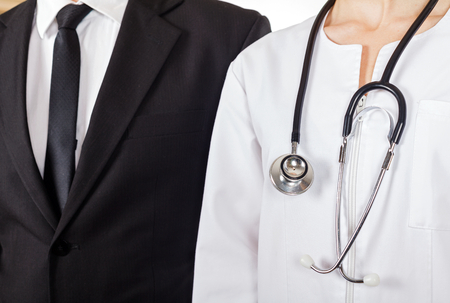 malpractice: Young doctor and businessman have a meeting Stock Photo