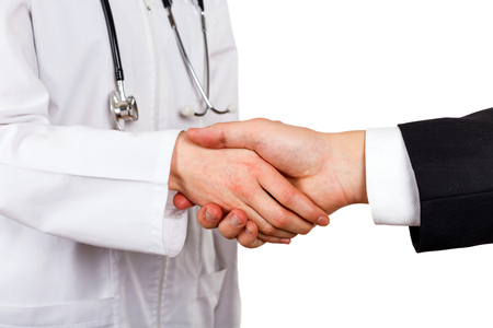 Woman doctor and her lawyer shaking hands Stock Photo