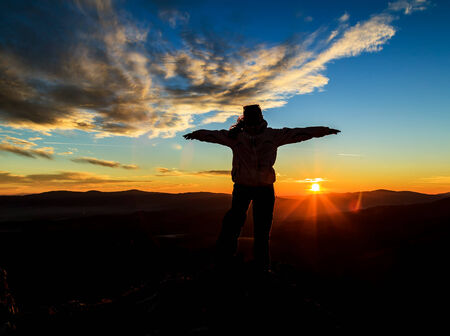 Silhouette photo and sunset on the top of mountains photo