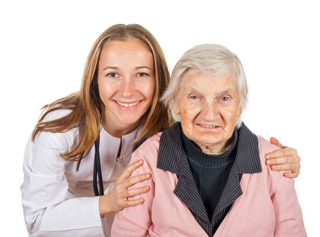 carers: Elderly woman with her helpful medical assistant