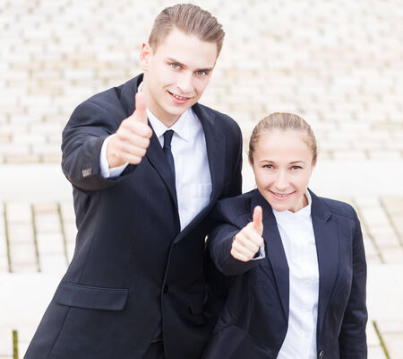 Young happy business people enjoy their promotion Stock Photo