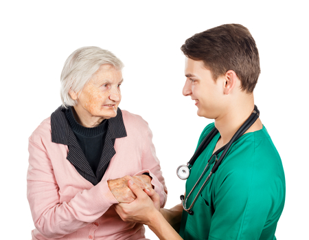 medical assistant: Elderly woman with her helpful medical assistant