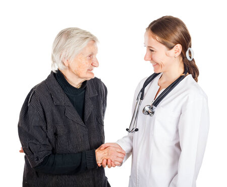 aide: Elderly woman with her helpful medical assistant