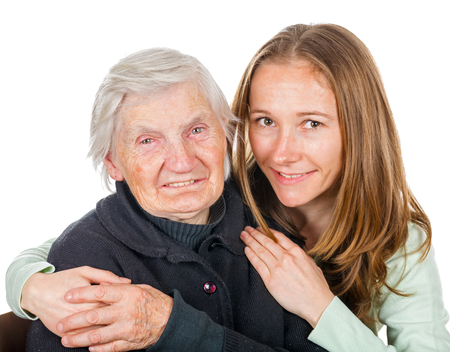 old carer: Portrait of young lady embracing the elderly woman Stock Photo