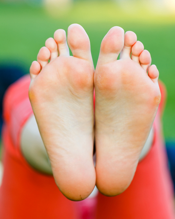 Closeup photo of young woman bare feet  Stock Photo