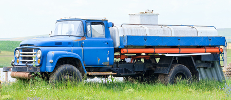 Vintage classic dairy truck in the industry yard  photo