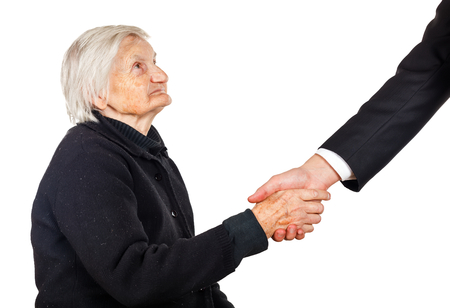 senior carers: Elderly woman shaking hands with her lawyer Stock Photo