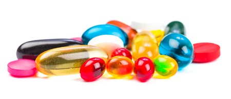 Closeup photo of colorful pills on white isolated