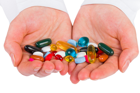 Closeup photo of colorful pills in hands