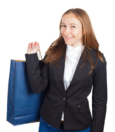 Happy young businesswoman carrying a paper bag  Stock Photo - 26778379