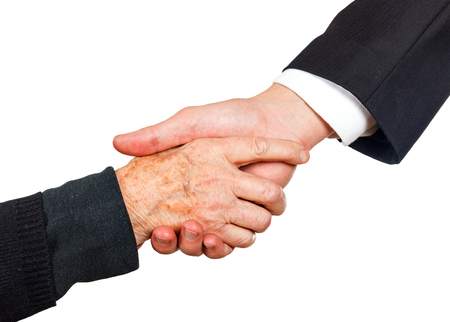 Young businessman shaking hand with elderly woman photo