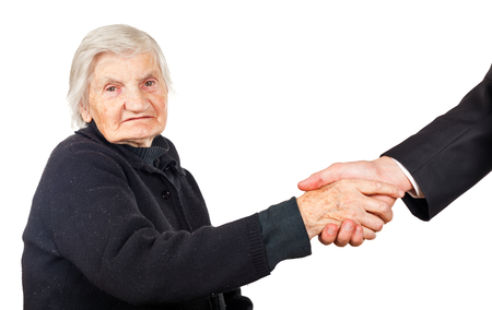carers: Elderly woman shaking hands with her lawyer Stock Photo