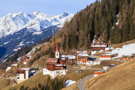 Photo of a small mountain village in the Alps photo